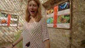 Walking in garden butterflies in Crimea stock video footage