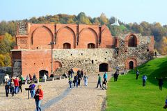 Walking on the Gediminas caltle hill in Vilnius city. VILNIUS, LITHUANIA - OCTOBER 12: Walking on the Gediminas caltle hill in Vilnius city on October 12, 2014 stock image