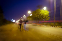 Walking ghost traffic light tails Royalty Free Stock Photography
