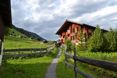 Walking in Gimmelwald. The walking path between houses in the small town of Gimmelwald, Switzerland Royalty Free Stock Photography