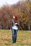 Walking girl. Beautiful young woman in autumn park Royalty Free Stock Photo