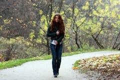 Walking girl. Beautiful young woman in autumn park Stock Photos