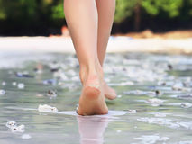 Walking girl on the beach. Girl walking on sand beach leaving footprints stock images