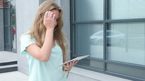 Walking Girl Browsing on Tablet stock video footage