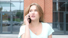 Walking Girl Busy Talking on Phone stock footage