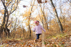 Walking Girl in Forest. Walking girl with toy in hand in forest Stock Photography