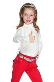 Walking girl holds thumb up Royalty Free Stock Photos