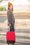 Walking girl with luggage Royalty Free Stock Image