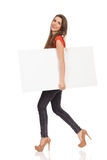 Walking girl with a message Royalty Free Stock Images