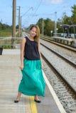 Walking girl on platform Stock Image