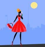 Walking girl in red Stock Photos