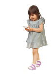 Walking girl searching on phone mobile Royalty Free Stock Photography