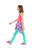 Walking girl, side view. Royalty Free Stock Photo