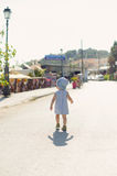 Walking Girl in Street Stock Images