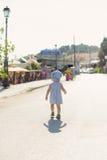 Walking Girl in Street Royalty Free Stock Image