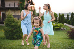 Walking Girl and Two Women Royalty Free Stock Photography