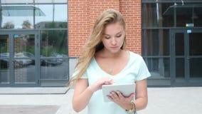 Walking Girl Using Tablet. Creative designer , businessman stock video
