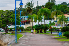 Walking girls. Girls walking in the beautiful park among palm trees in Samana, Dominican Republic Royalty Free Stock Images