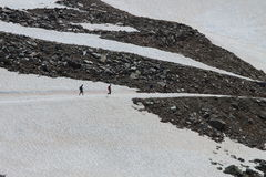 Walking on a glacier in the Alps. Walking on ice in mountain stock photo