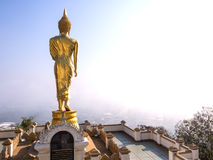 Walking golden buddha statue viewpoint in Nan Royalty Free Stock Images