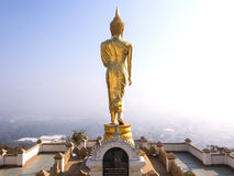 Walking golden buddha statue viewpoint in Nan Royalty Free Stock Photography