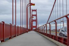 Walking the Golden Gate Bridge. Alone on the Golden Gate Bridge sidewalk on a cloudy day. Photo taken in January 2019 stock photo
