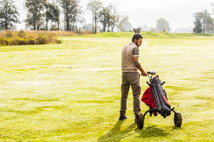 Walking golf player Royalty Free Stock Photos