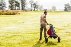 Walking golf player Royalty Free Stock Photos