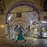 Walking in the Grand Bazaar in Istanbul. ISTANBUL, TURKEY – APRIL 26: Couple walking in the Grand Bazaar in Istanbul prior to Anzac Day on April 26, 2012 in Stock Image