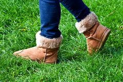 Walking on grass in boots Royalty Free Stock Image