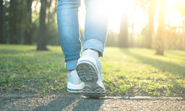 Walking in gray running shoes, back to camera. Walking in gray running shoes good for everyday wearing, blue jeans, back to camera stock photo