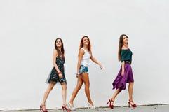 Walking group of young women Stock Photo