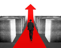 Walking on growing red arrow through 3d maze Royalty Free Stock Images