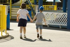 Walking hand in hand. Children at amusement park walking hand in hand Stock Photography