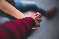 Walking hand by hand. A young couple hand by hand Stock Images
