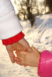 Walking hands together. Mother guiding daugher hand in hand on the walk. Trust concept. Background Stock Image