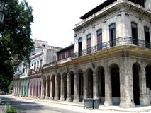 Walking in Havana n. 7. An emty street in Havana (Cuba), colored old typical buildings Royalty Free Stock Images