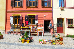 Walking in historic town Sighisoara. City in which was born Vlad Tepes Dracula. SIGHISOARA, ROMANIA - JULY 08, 2015: Walking in historic town Sighisoara. City in Stock Photo