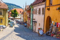 Walking in historic town Sighisoara. City in which was born Vlad Tepes Dracula. SIGHISOARA, ROMANIA - JULY 08, 2015: Walking in historic town Sighisoara. City in Stock Photos