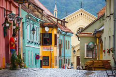 Walking in historic town Sighisoara on July 17, 2014. Stock Photography