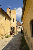 Walking through history. A small piece of the inner courtyard in Rasnov Frortress Royalty Free Stock Photo