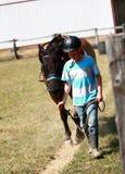 Walking the Horse. A young boy walks his horse around the corral Stock Photos