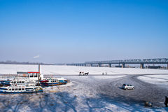 Walking on ice. People behavior on the surface of the frozen songhuajiang river Stock Image