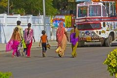 Walking Indian family Stock Photo
