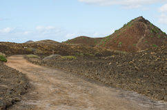 Walking on the island of Lobos. Paths of the island of Lobos, islet north of Fuerteventura, in the Canary Islands Royalty Free Stock Image