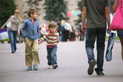 Walking kids. On urban street Stock Images