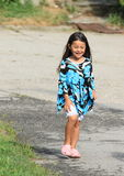 Walking laughing little girl Royalty Free Stock Photography