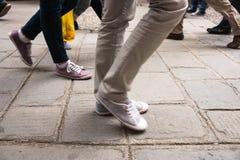 Walking legs on European cobbled street motion blur Royalty Free Stock Image