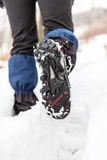Walking legs and shoes on snow trail in winter Royalty Free Stock Photography
