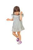 Walking little girl talk to cell phone Royalty Free Stock Images